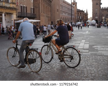 Ferrara, Italy - September 8, 2018. People and tourists, bicycles on the main square.