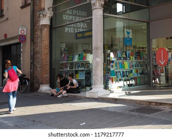 Ferrara, Italy - September 8, 2018. Historic center, Saturday afternoon in September, young people in front of the large bookshop.