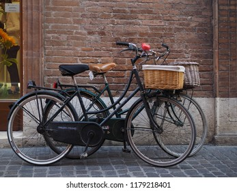 Ferrara, Italy - September 8, 2018.  Saturday afternoon of shopping in the historic center, two bicycles in front of a shop.