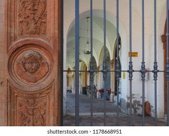 Ferrara, Italy - September 9, 2018. Certosa monumental cemetery. Decoration outside the cemetery and part of a railing.