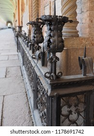 Ferrara, Italy - September 9, 2018. Certosa monumental cemetery. Nineteenth-century railing in front of a tomb.