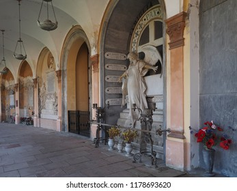 Ferrara, Italy - September 9, 2018. Certosa monumental cemetery. Ancient portico with tombstones.