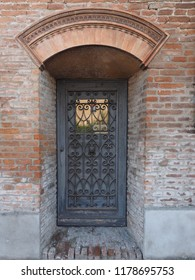 Ferrara, Italy - September 9, 2018. Certosa monumental cemetery. Door that leads into the interior rooms of the cemetery.