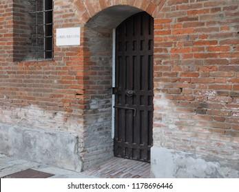 Ferrara, Italy - September 9, 2018. Certosa monumental cemetery. Morgue, entrance door.