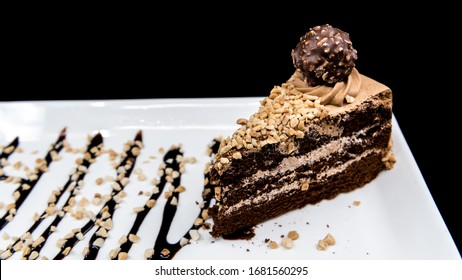 Ferrero Rocher Cake with sprinkles and sauce