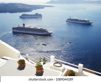 Ferries running on Aegeans Sea at Santorini island, Greece.