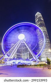 Ferries wheel with skyscraper in Central, Hong Kong at night