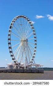 Ferris of National Harbor pier in Maryland, USA. National Harbor waterfront on a bright sunny day.