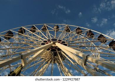 Ferris wheel against a bright blue sky.