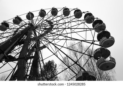 Ferris wheel in amusement park in dead abandoned ghost town of Pripyat, Chernobyl NPP exclusion zone, Ukraine