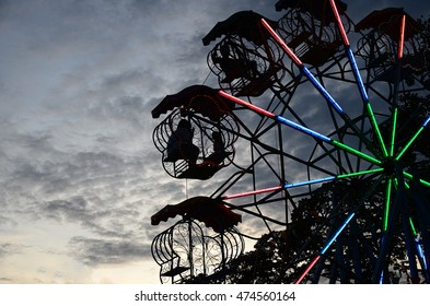 Ferris wheel at amusement park at evening in thailand