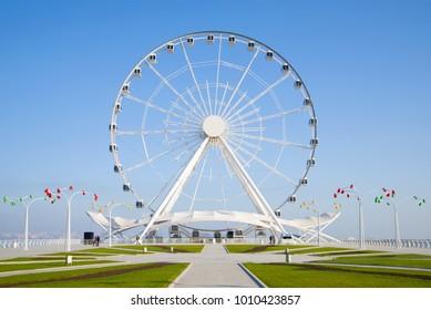 Ferris wheel close-up against the blue sky. Baku, Azerbaijan