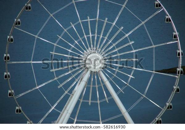 Ferris wheel at evening. fair ride on Ferris wheel at entertainment and amusement park. Amusement park entertainment. Fairground ride at night entertainment and amusement park Fairground night Baku