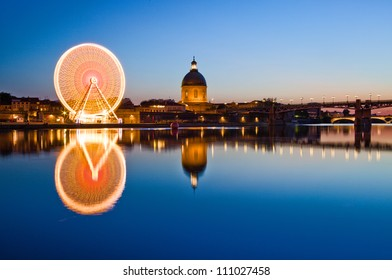 Ferris wheel in the evening in Toulouse city center, France
