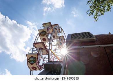 Ferris wheel at the fair with sunshine