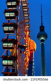 Ferris Wheel and Fernsehturm at Night Christmas Market at Town Hall in Winter Berlin, Germany.
