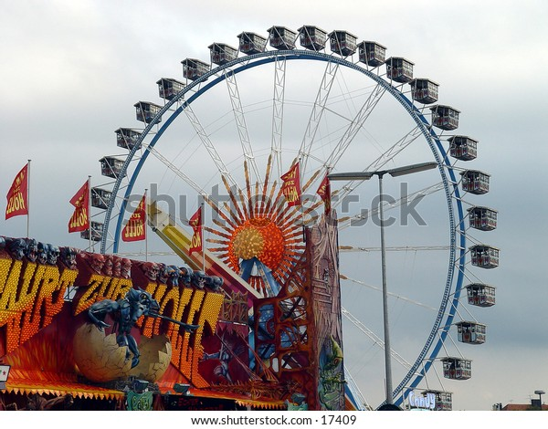 Ferris wheel with ghost train in foreground