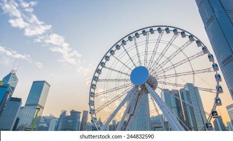 Ferris Wheel in Hong Kong, with landmark buildings.