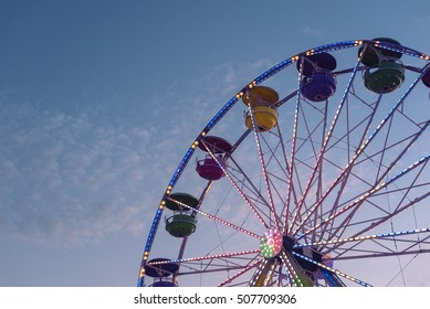 Ferris wheel isolated on blue sky background