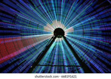 Ferris Wheel with long exposure, movement on a fair, blue long exposure