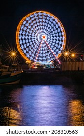 Ferris wheel in motion at night, Honfleur, Normandy, France