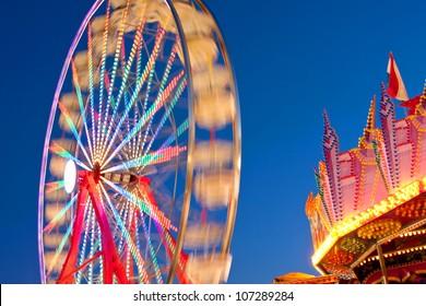 Ferris Wheel Movement Blurs Against Blue Sky At Dusk