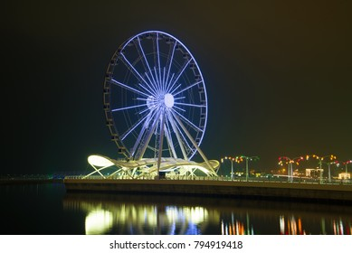 Ferris wheel in the night landscape. Evening Baku, Azerbaijan