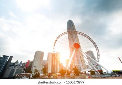 Ferris wheel and office buildings in Hong Kong.
