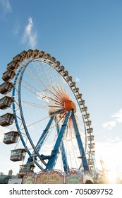 Ferris wheel at Oktoberfest in Munich, Germany - September 29, 2016: View on ferris wheel at Oktoberfest in Munich under blue sky