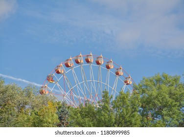 Ferris wheel on the background of blue sky background