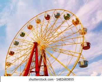 ferris wheel on background of blue sky