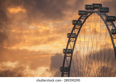 Ferris Wheel on the background of evening sky, Singapore