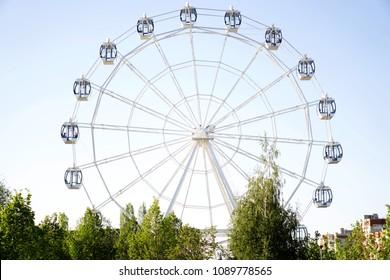 Ferris wheel on blue background