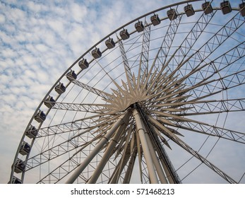 Ferris wheel on blue sky with cloud in Bangkok,Thailand
