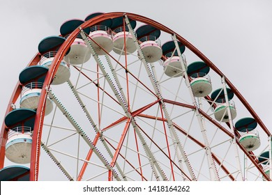 Ferris wheel on cloudy sky background in the daytime