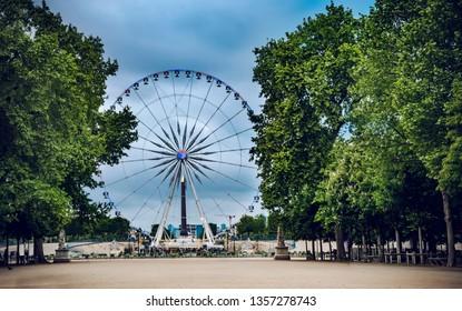 Ferris wheel on the Place de la Concorde from Tuileries Garden in Paris, France