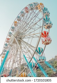 Ferris wheel on sky and mountain background.