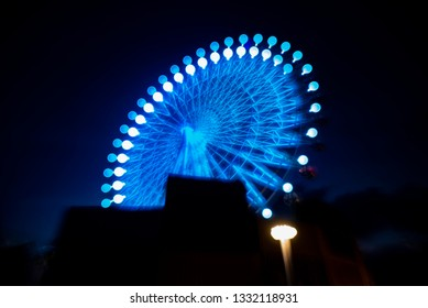 Ferris wheel with outdoor at night. Blurry image