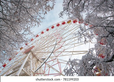 The Ferris wheel in the park in winter is covered with snow, a beautiful winter frosty day, snowfall