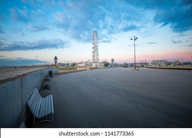 Ferris wheel in Rimini. Rimini attractions. View from central pier.