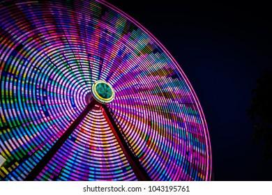 Ferris Wheel in Slow Motion against a Night Sky