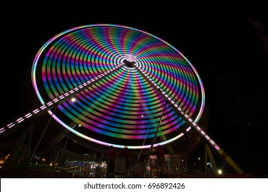 Ferris wheel spinning at the Midway at National Cherry Festival in Traverse City, Michigan