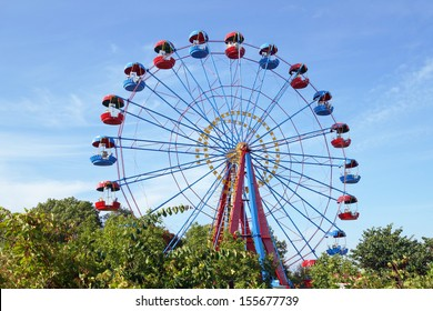 Ferris wheel in the summer morning