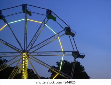 Ferris wheel at twilight.