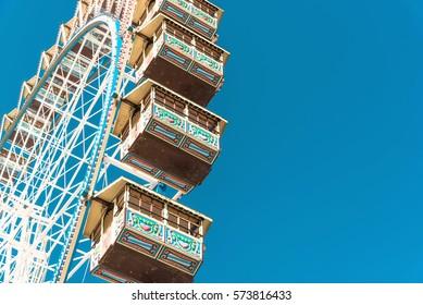 ferris wheel under blue sky at Oktoberfest in Munich