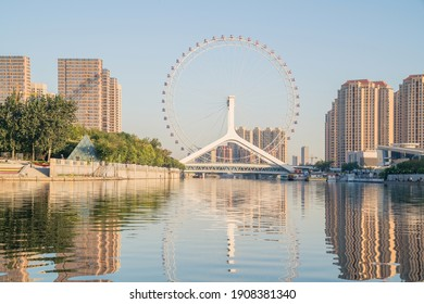 Ferris wheel,Bridge,City scenery and modern architecture skyline by the Haihe River in Tianjin, China