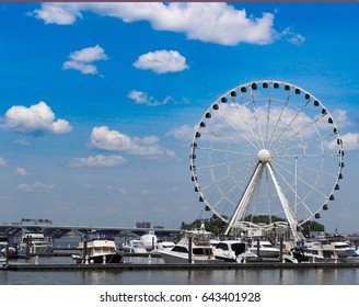Ferriswheel with sailboats and blue sky