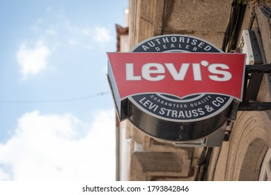 Ferrol / Galiza / Spain - 08 08 2020: Levi's Strauss logo and sign in store facade with sunny sky copy space. Levi's Strauss & Co. is an american clothing company known worldwide for its denim jeans