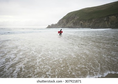 FERROL, SPAIN - AUGUST 16: Surfer on Campelo beach AUGUST 16, 2015, Ferrol. Campelo is a fairly exposed beach break that has consistent surf. Offshore winds are from the northeast.