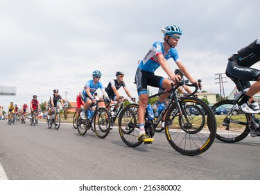 FERROL, SPAIN - SEPTEMBER 10: Unknown racers on the competition Tour of Spain (La Vuelta) on September 10, 2014 in Ferrol, Spain. The photo shows cyclists in a row